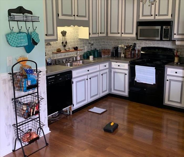 kitchen with water damage from dishwasher