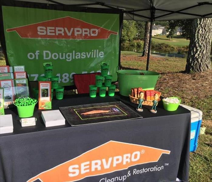Our tent set up with fun giveaways for the golfers.